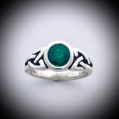 Trinity rings with created emerald setting